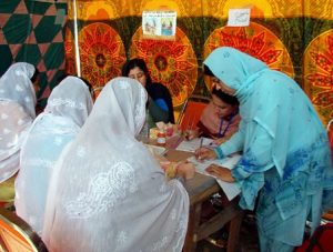 Picture 3 - Afghan women register to vote before the election. © 2004 The Advocacy Project, CC BY-ND 2.0